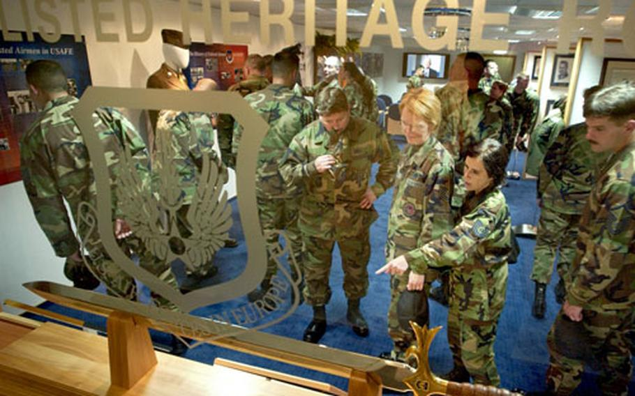 Students from a local Non Commissioned Officers Academy class look at items on display in the new Parish Enlisted Heritage Room located in the USAFE Headquarters building at Ramstein Air Base.