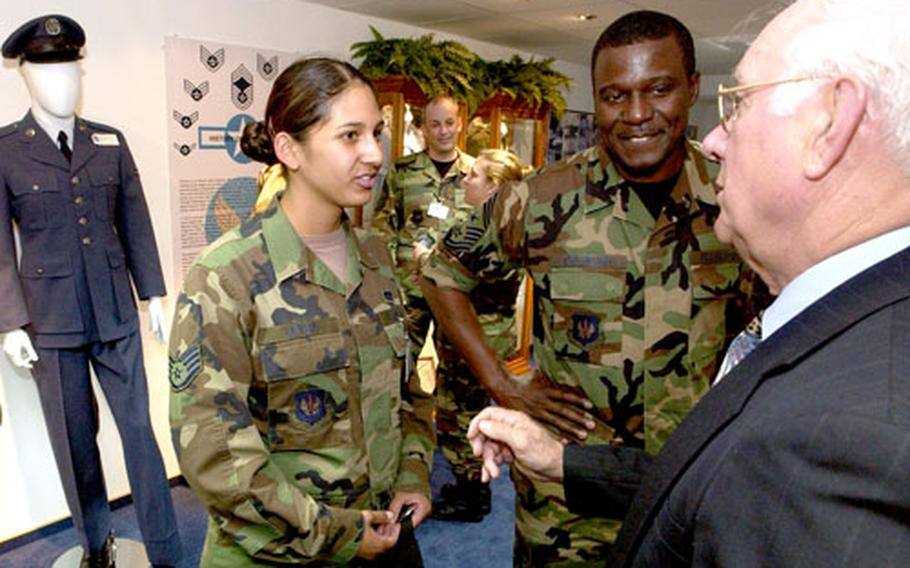 Staff Sgt. Melissa Leyba, a builder assigned to the 735th Civil Engineering Squadron, talks with retired Chief Master Sgt. Sam Parish, right, and USAFE Command Chief Master Sgt. Gary Coleman about the new Parish Enlisted Heritage Room. Leyba helped build the room, which is named after Parish.