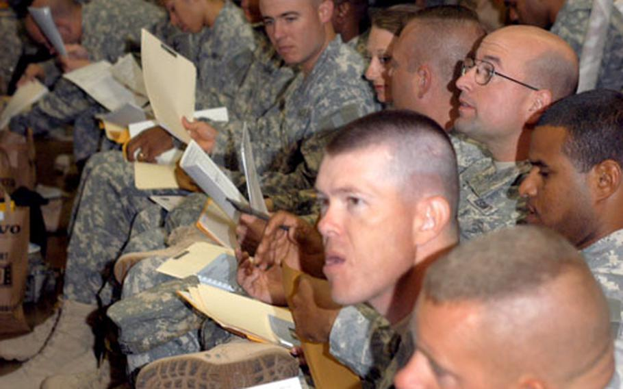 Scores of soldiers with the 130th Engineer Brigade in Hanau, Germany, sift through paperwork on the first day of a reintegration process that all redeploying soldiers go through. About 100 engineers returned Sunday after a yearlong deployment to Iraq.