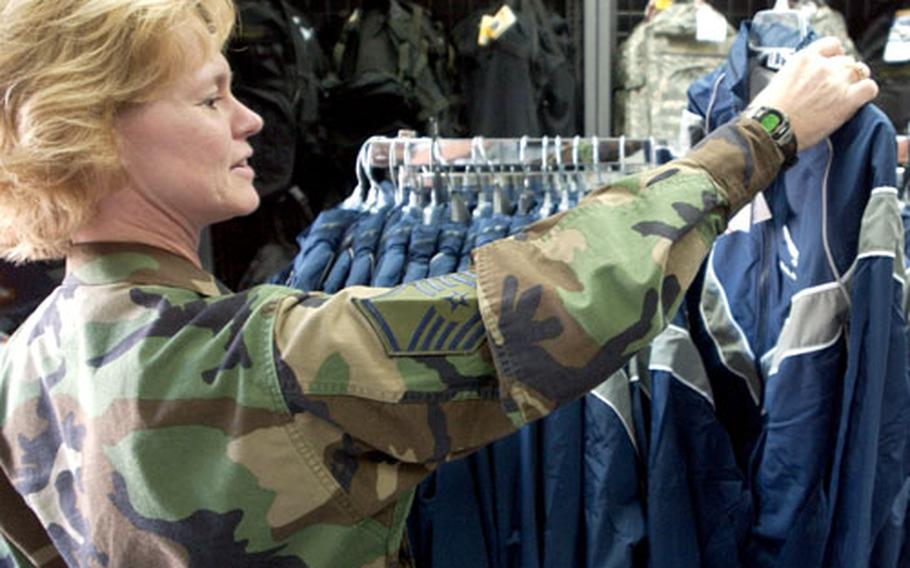 Master Sgt. Jeanne Berry, who is assigned to the Readiness Management Group Detachment 9, looks for her size of PT gear at the Ramstein Air Base, Germany, clothing sales store Friday. With the Air Force PT gear mandatory wear date of Oct. 1 near, clothing sales stores are trying to keep the new uniform in stock.