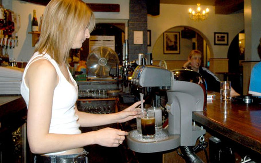 Bartender Donna Bray makes drinks on a recent night at the Temple Bar in Newmarket.