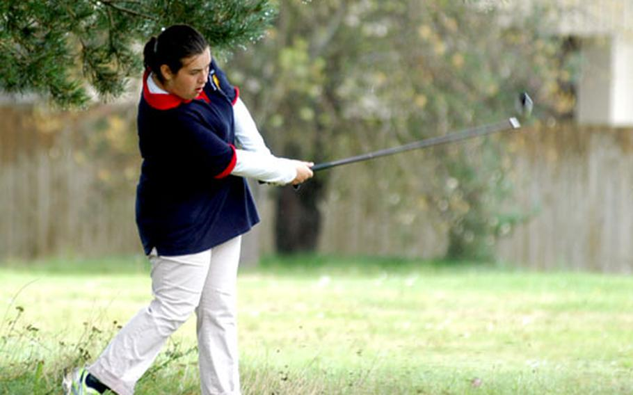 Ramstein golfer Patsy Young hits out of the rough onto the fairway along the 10th hole during a high school tournament Friday at Breckland Pines Golf Course.