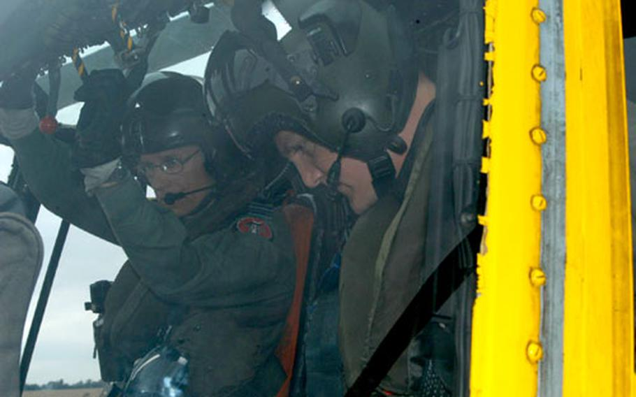 U.S. Coast Guard Lt. Tyson Weinert and RAF Flight Lt. Steve Murkin prepare to take off in the RAF Sea King search-and-rescue helicopter. Weinert is the lone American in the squadron, part of a U.S.-U.K. military exchange program.