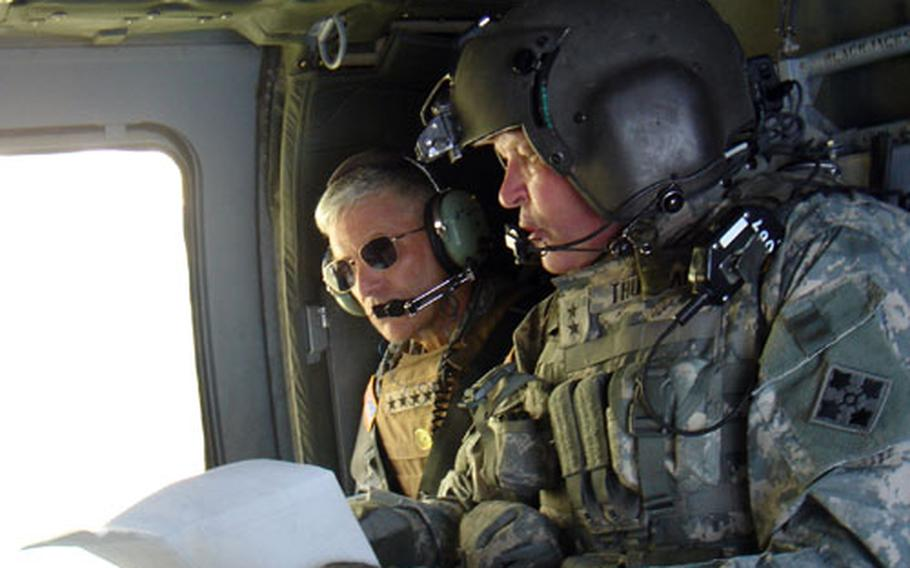 Gen. George Casey, right, the top U.S. general in Iraq, talks to Maj. Gen. James D. Thurman, commander of U.S. forces in Baghdad, during a visit to a northern Baghdad neighborhood. Thurman has been nominated to take the helm of V Corps.