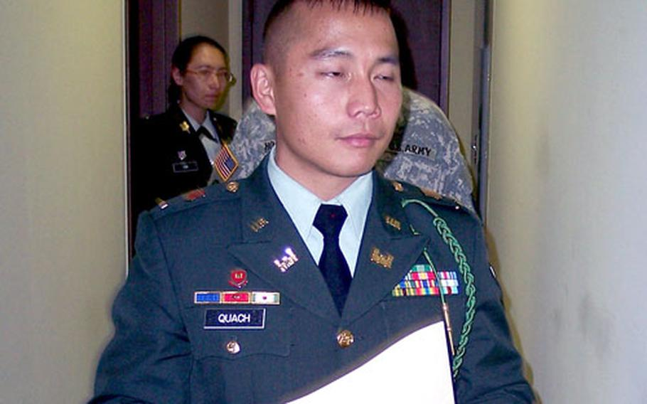 Second Lt. Phuong Quach walks out of a Camp Casey courtroom Tuesday after being convicted on charges of indecent assault and making a false sworn statement. Military judge Col. Gregory Gross sentenced Quach to one year in jail, forfeiture of all pay and dismissal from the Army.