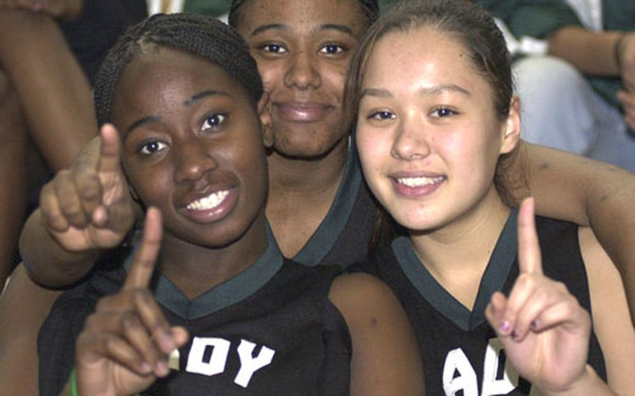 """Lynette Grant, left, was killed Friday in an automobile accident near Jacksonville, Ala., where she was a freshman at Jacksonville State. She is pictured above as a high school senior with fellow Taegu American athletes Tamara """"Tank"""" Hancock and Kelli Cox."""