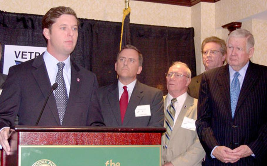 Patrick Murphy, left, a former Army captain, speaks about his run for Congress in Pennsylvania Wednesday in Washington. With Murphy are, from left, retired sailor Richard Sexton from New Jersey; retired Marine Phil Avillo from Pennsylvania; retired airman Jay Fawcett from Colorado; and Rep. John Murtha, D-Pa, a former Marine.