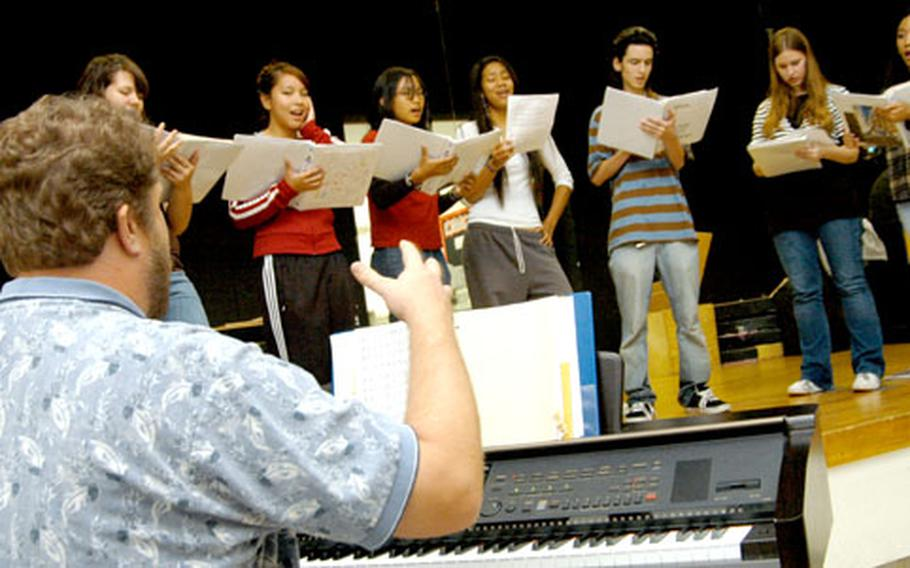 """The Nile C. Kinnick Show Choir practiced Wednesday for the United Nations' environment-focused """"Our Forest Is Alive"""" show in Kawasaki on Sunday. The choir performed more than 30 times in 2005."""