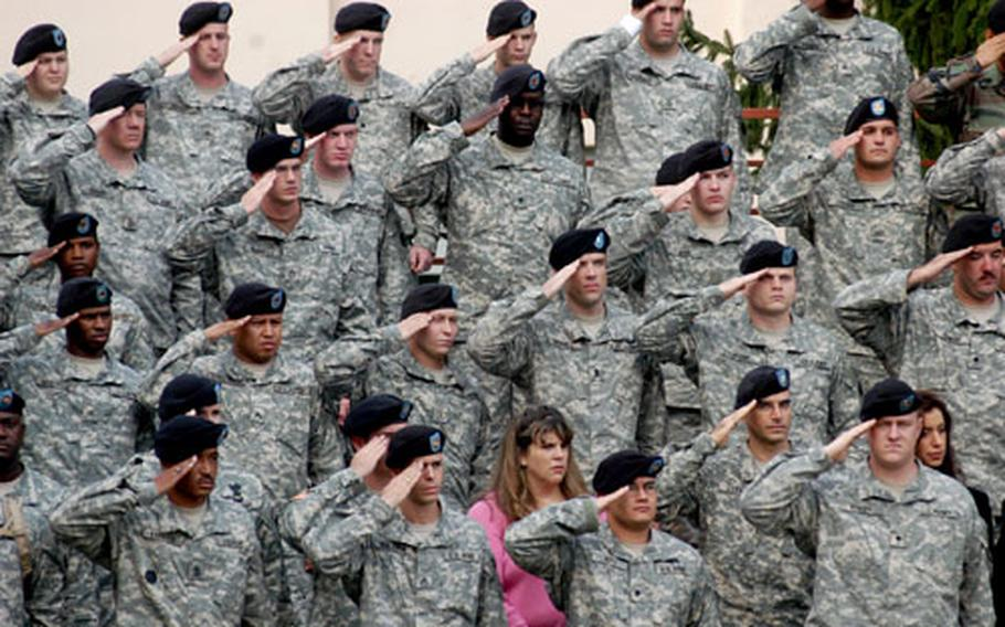 Soldiers of the 3rd Corps Support Command stand and salute during Thursday's change of command ceremony in Wiesbaden, Germany.