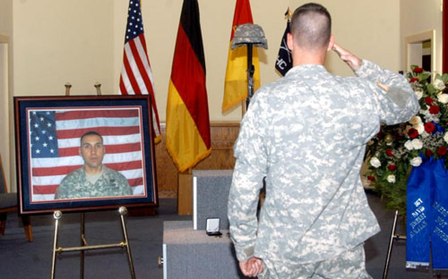 Members of the Friedberg military community in Germany on Friday gathered for a memorial service for Sgt. David J. Almazan, who died in combat in Iraq on Aug. 27. Snapping a salute in Almazan's honor is Pvt. Brendan Burkhardt.
