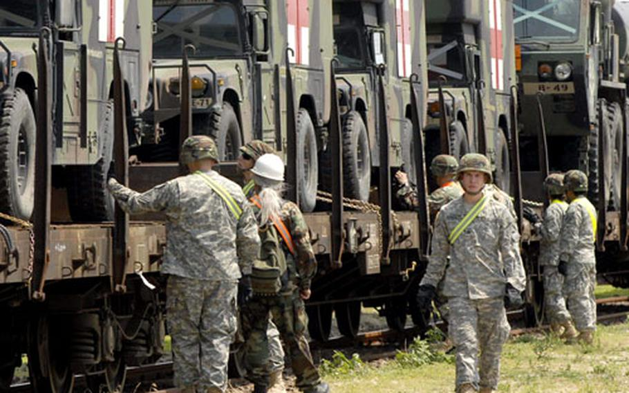 Soldiers from Dexheim, Germany, remove vehicles from rail cars during this year's Immediate Response exercise in Bulgaria. U.S. Army Europe officials expect planned rotation of forces into Romania to start next year.