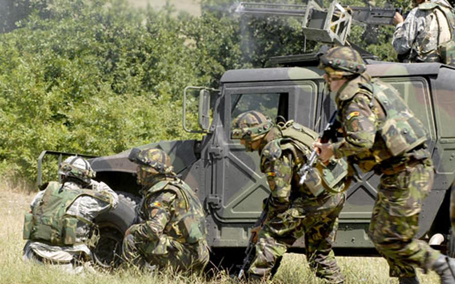 A squad of soldiers maneuvers to engage the enemy during a convoy ambush training exercise at the Novo Selo Training Area, Bulgaria, in July.