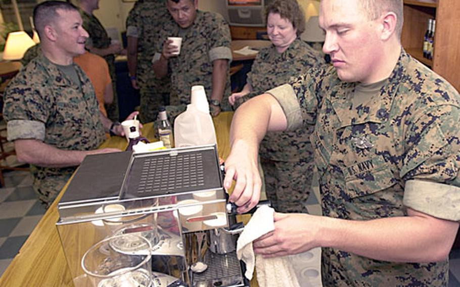 Petty Officer 3rd Class Anthony Duval serves specialty coffees at the opening of Schwabucks on Friday on Camp Schwab, Okinawa.