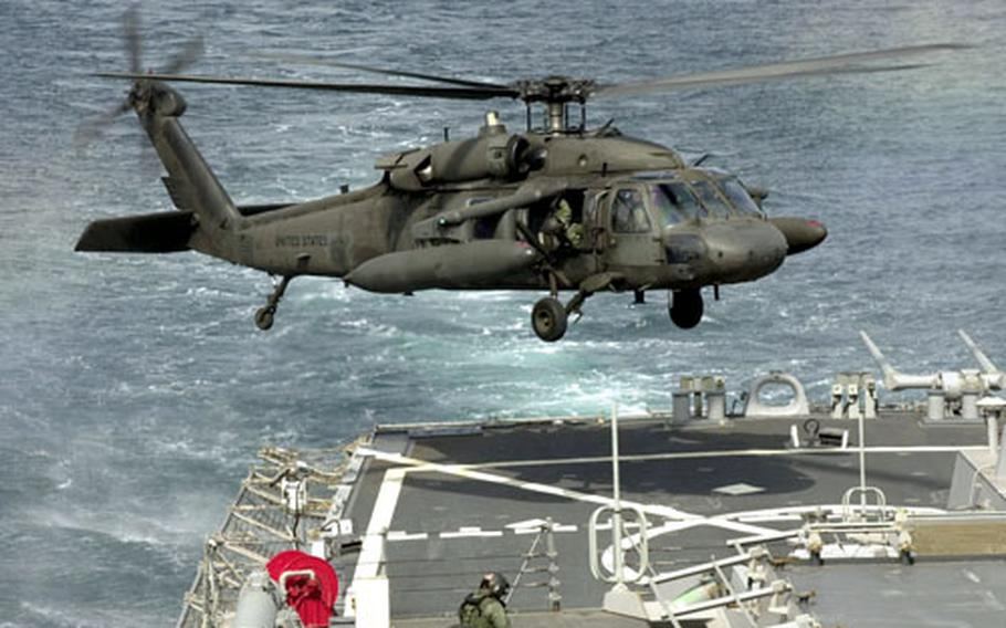 An Army UH-60 Black Hawk comes in for a landing on the back deck of the USS Curtis Wilbur during training in March off west coast of South Korea. Korean hikers recently discovered the remains of a similar helicopter that crashed northeast of Seoul in 1998.
