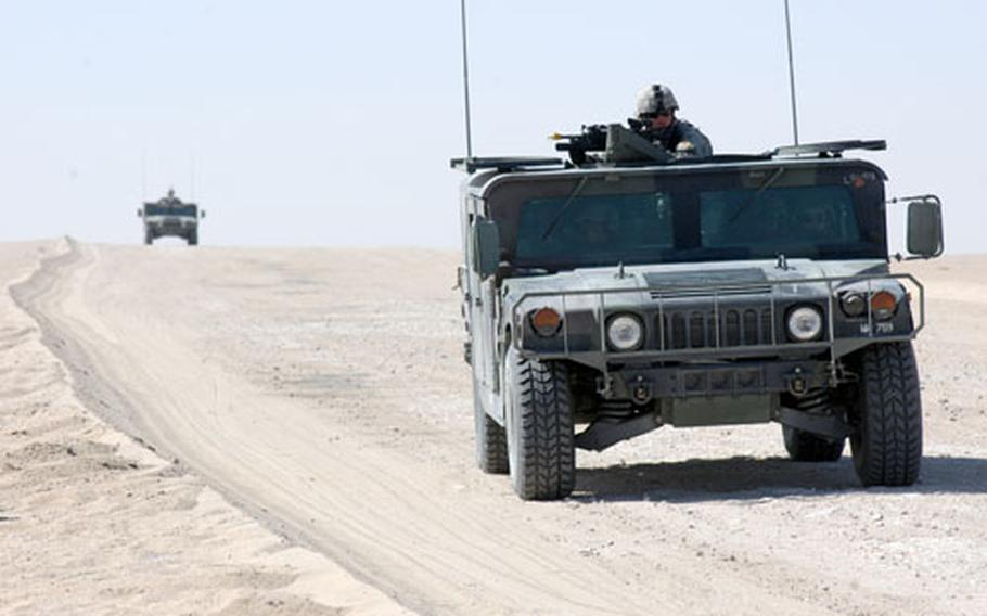 Soldiers with the 9th Engineer Battalion, based in Schweinfurt, Germany, convoy through the desert as part of a reconnaissance and clearance drill in northwestern Kuwait.