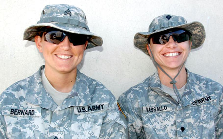 Sgt. Brienne Bernard, left, and Spc. Desiree Vassallo, Arabic linguists with the 2nd Brigade Combat Team, 1st Infantry Division, based in Schweinfurt, Germany, are looking forward to their first deployment in Iraq, where they'll be able to use Arabic instead of their motorpool talents.