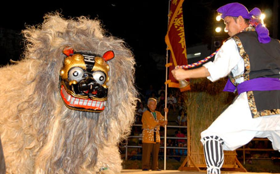 A shishi pounces around the stage during a performance Sunday night at the Lion Dance Festival in Uruma.