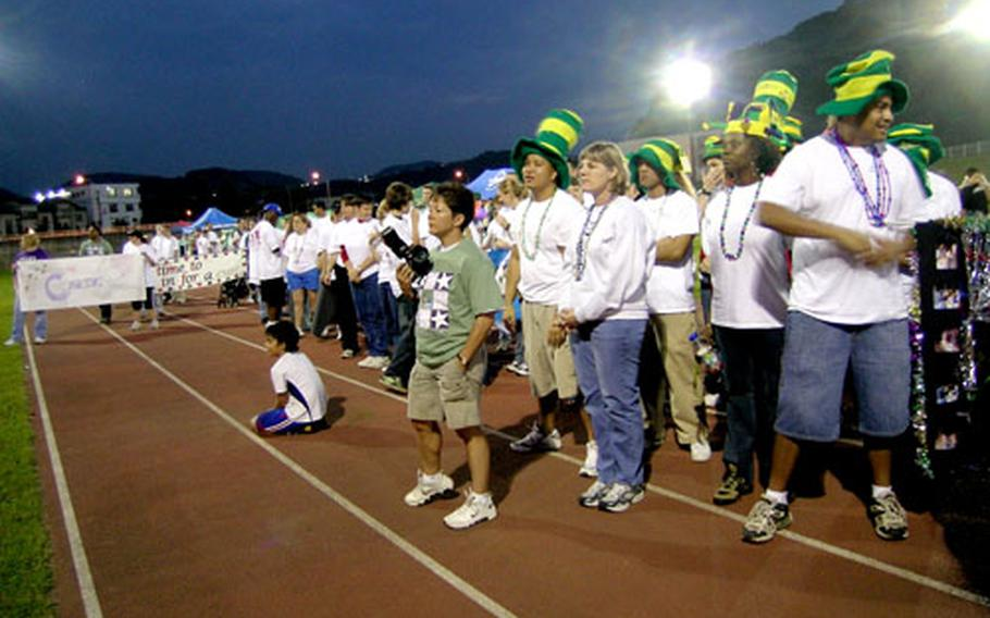 Japan's first Relay for Life event Saturday drew hundreds of walkers to the Ikego Housing Area for the all-night event. Over $57,000 was raised for American Cancer Society research.