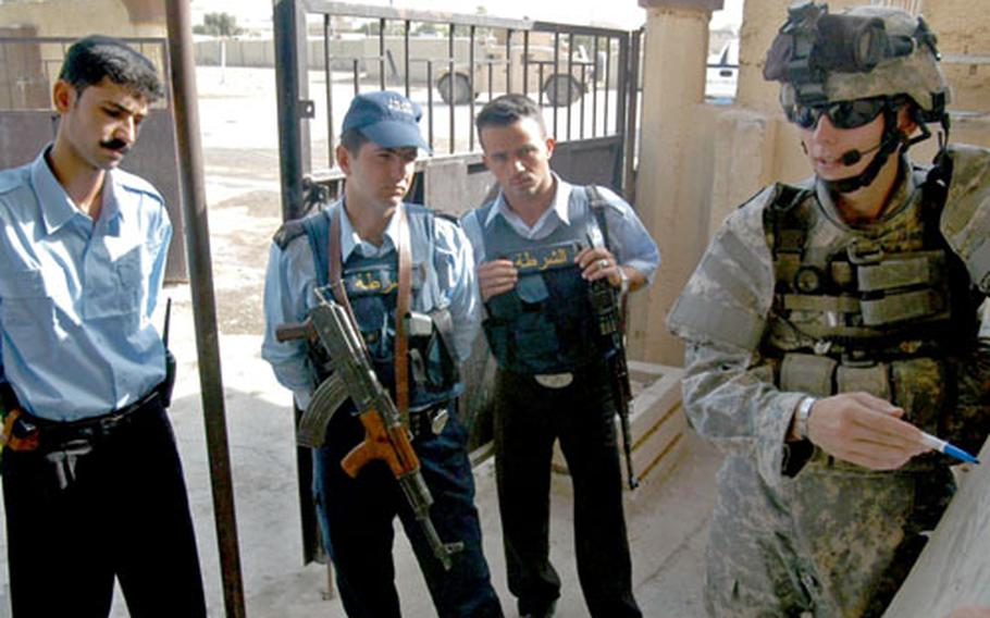 Sgt. Andrew Wilson, of Company C, 2nd Battalion, 35th Infantry Regiment, stationed in Kirkuk, teaches a group of Iraqi police how to respond to a roadside bomb if attacked while in a convoy in the city. Policeman Haresh Maroof, far left, said the American training has helped the local force.