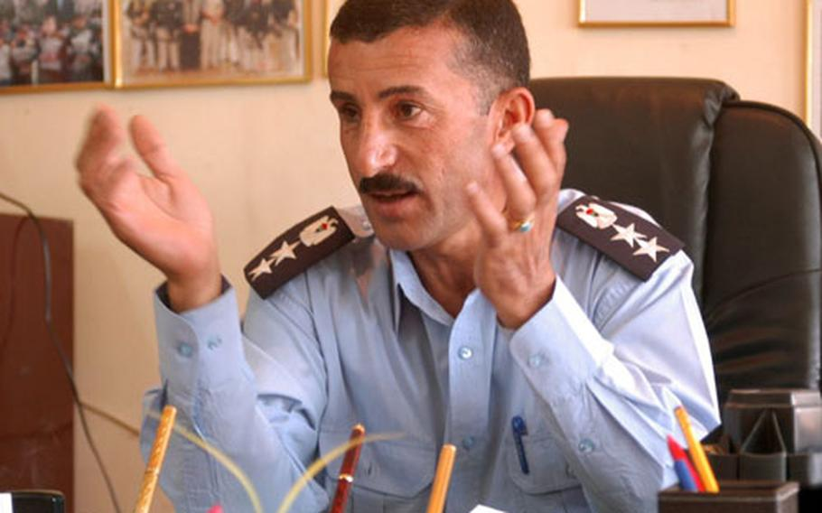Col. Sherzad Marif Ahmed, commander of the Aruba police station in Kirkuk, outlines the shortages his department suffers due to intimidation by insurgents.