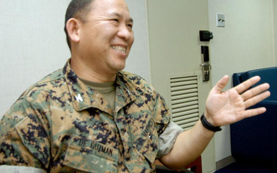 Col. Rick De Guzman explains how the Naval Operations Concept will affect the 7th Fleet. The document, signed Sept. 1, mandates more Navy-Marine Corps communication. DeGuzman, a Marine, is the Plans/Theater Security Cooperation officer.