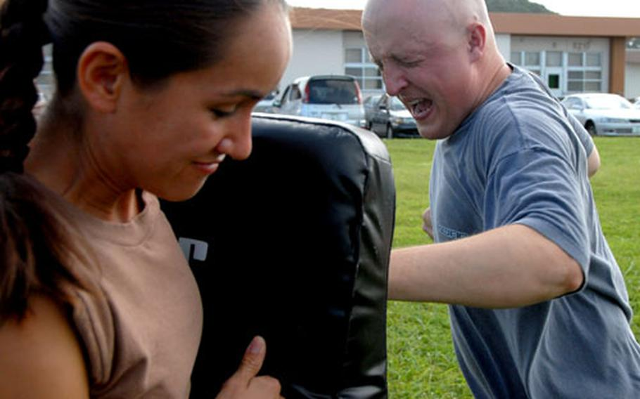 """Seaman Chris Graczyk hits the punching bag after being sprayed with pepper spray. """"I was able to keep my eyes open for the most part but it was a struggle,"""" he said."""