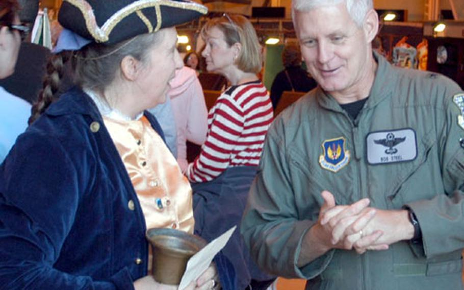 Lyn Goodger, town crier for King's Lynn, chats with 48th Fighter Wing commander Brig. Gen. Robert P. Steel shortly after the kickoff of the RAF Lakenheath annual bazaar last Friday.
