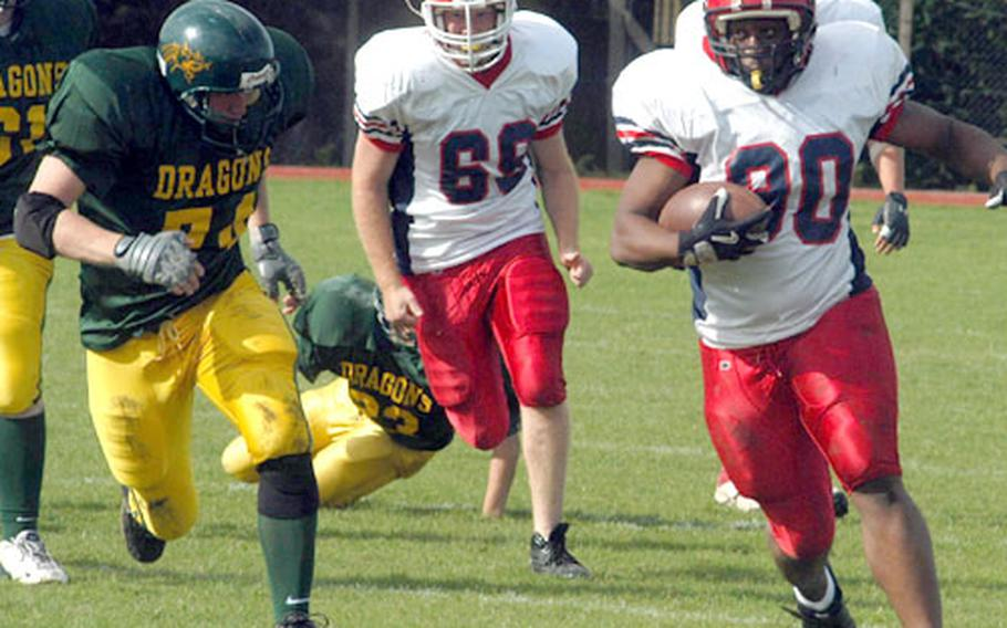 Menwith Hill running back LaShawn Adams enjoys room to run on one of his 12 carries for 155 yards Saturday against the Alconbury Dragons.