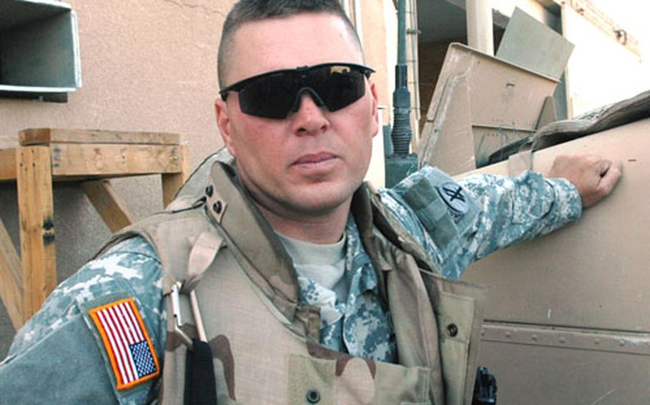 Missouri State Rep. Jason Brown is a 36-year-old reservist manning a Humvee gun turret in Iraq as a member of the Utica, N.Y.-based 414th Civil Affairs Battalion.