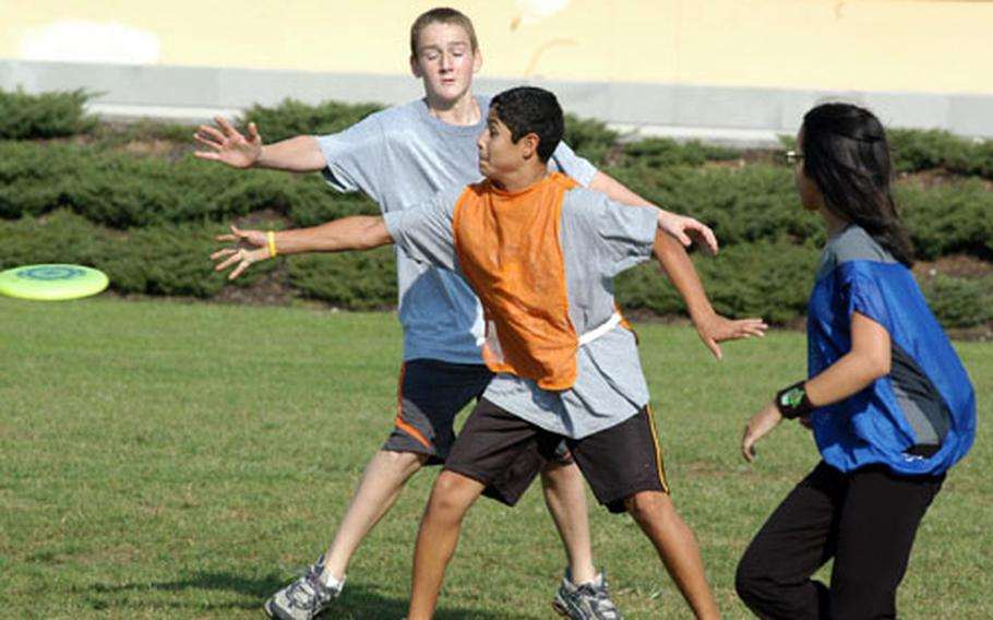 Perry Adams guards fellow eighth-grader Dario Santillan during a game of ultimate Frisbee. Physical education instructor Tim Morse has students engaged in a variety of non-traditional activities in his classes.