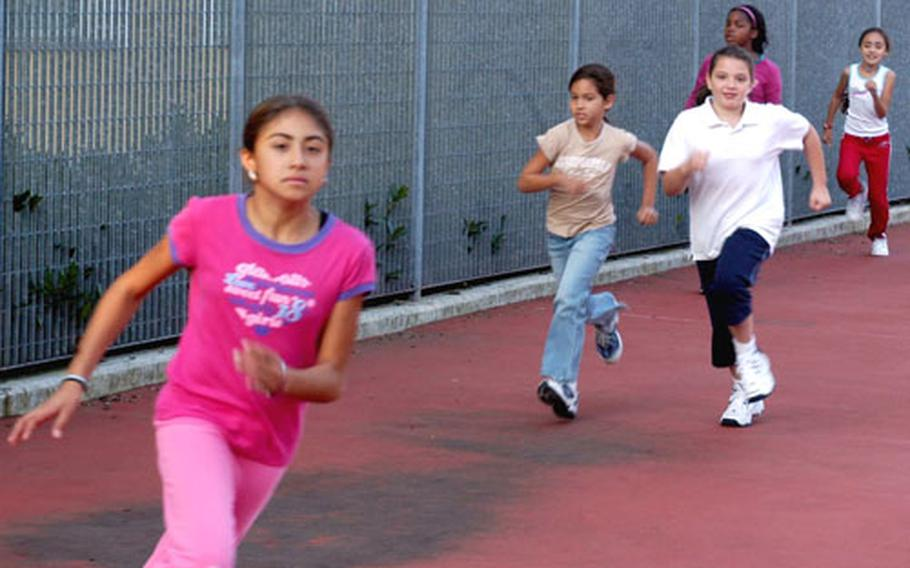 Fifth-graders in one of Julie Peressin's physical education classes at Aviano Elementary School race around an improvised track. Elementary students at Aviano participate in P.E. once a week.