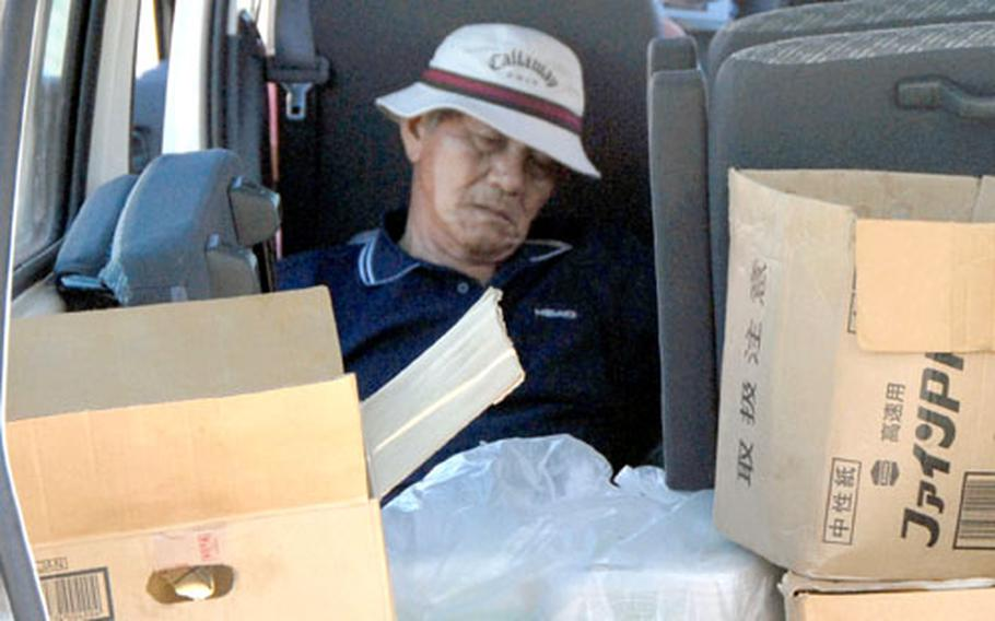 After about 16 hours of protesting, one of the group members catches some shuteye in the food service van.