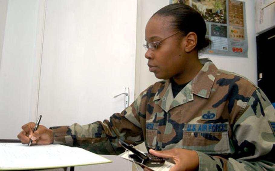 Staff Sgt. Latoya Straeter, an investigator for the 48th Security Forces Squadron, logs in the serial number of a mobile phone found on RAF Lakenheath. As part of her duties, Straeter helps run the squadron's lost-and-found program that holds onto lost jewelry, cash, credit cards and many other items until the rightful owner is found.