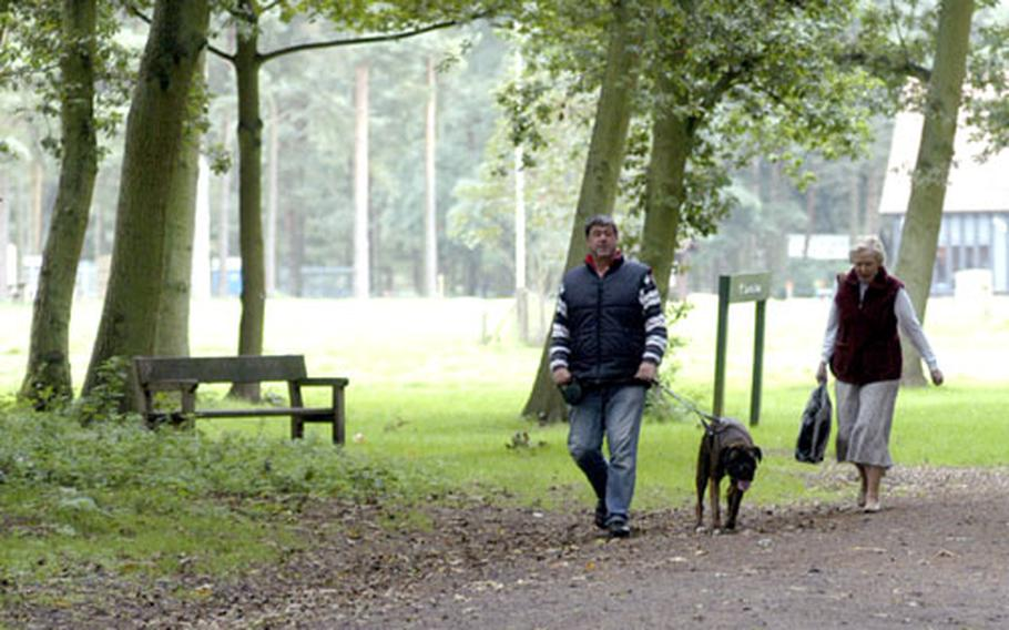 Visitors to the Thetford Forest take a stroll with their dog along one of the many paths found inside the forest, which is located near RAFs Lakenheath and Mildenhall.