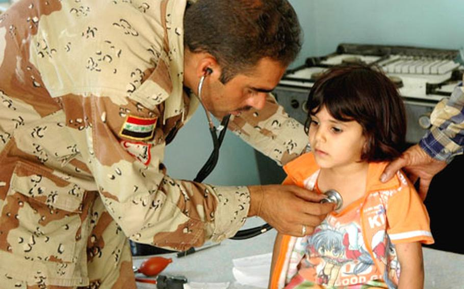Iraqi army medic Sadoon Karim was kept busy by a long stream of patients.