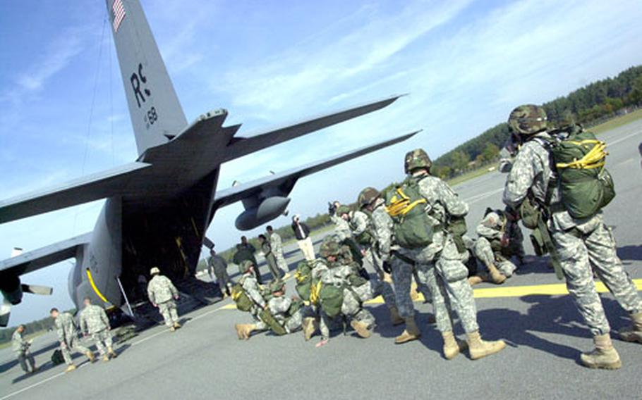 Soldiers from the 4th Battalion, 319th Airborne Field Artillery Regiment board a C-130 transport at Grafenwöhr Army Air Field on Tuesday.