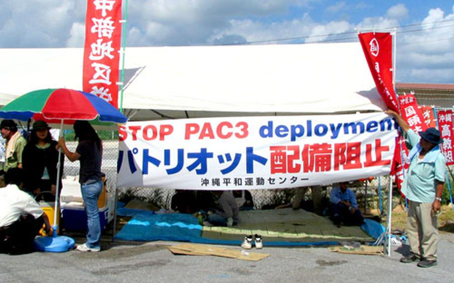 A tent set up at the entrace to tengan Pier on Okinawa by anti-military protesters.