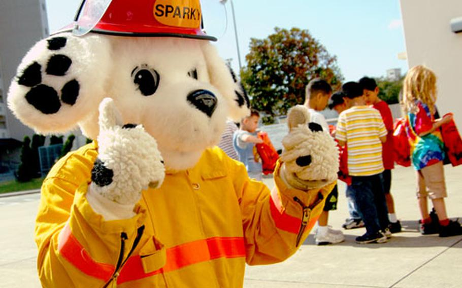 Sparky the Fire Dog gives the CNFJ Regional Fire Department's fire safety training the thumbs up Tuesday at Yokosuka Naval Base, Japan.