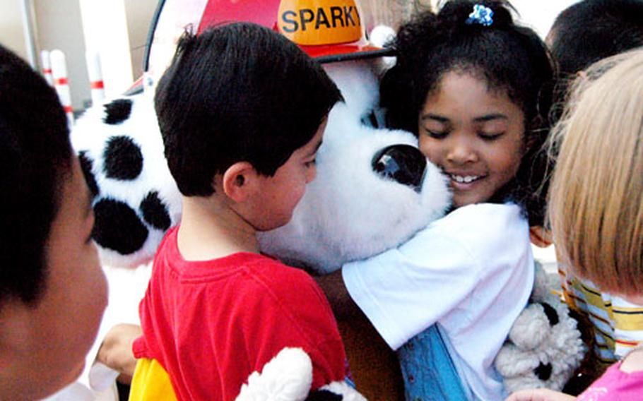 After his rescue from a burning building, Sparky the Fire Dog was comforted by students from The Sullivans School during the CNFJ Regional Fire Department's fire safety training Tuesday.