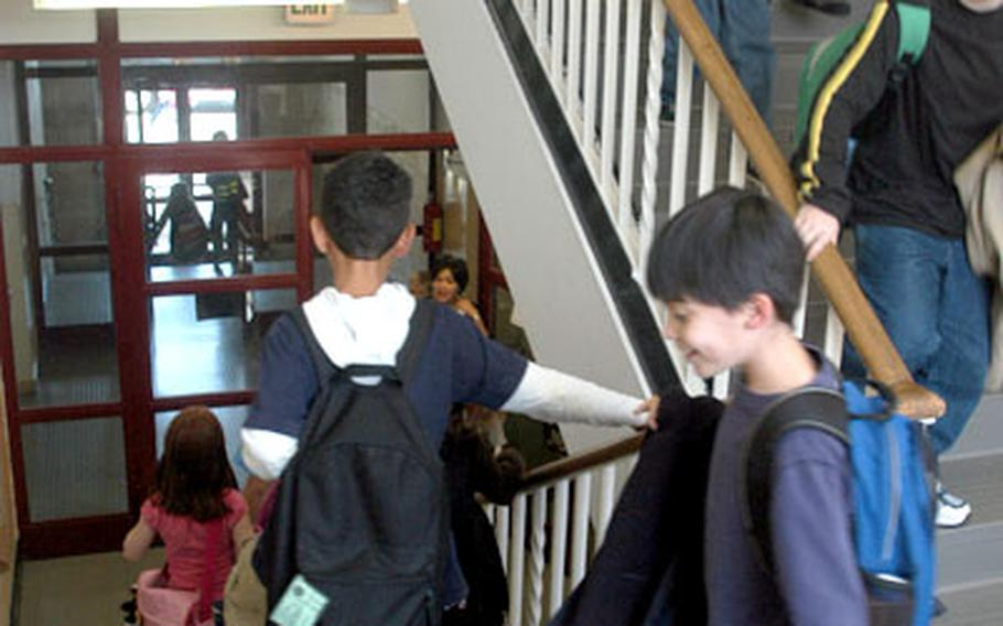Students go down one of two stairwells at the four-story, 525-student Boeblingen Elementary-Middle School. The school was cited for nine safety violations in a September inspection, and some parents are urging that safety improvements be made.