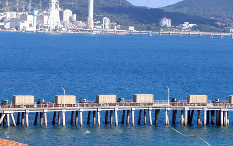 Trucks hauling Patriot missiles bound for Kadena Air Base prepare to leave Tengan Pier on Wednesday morning.