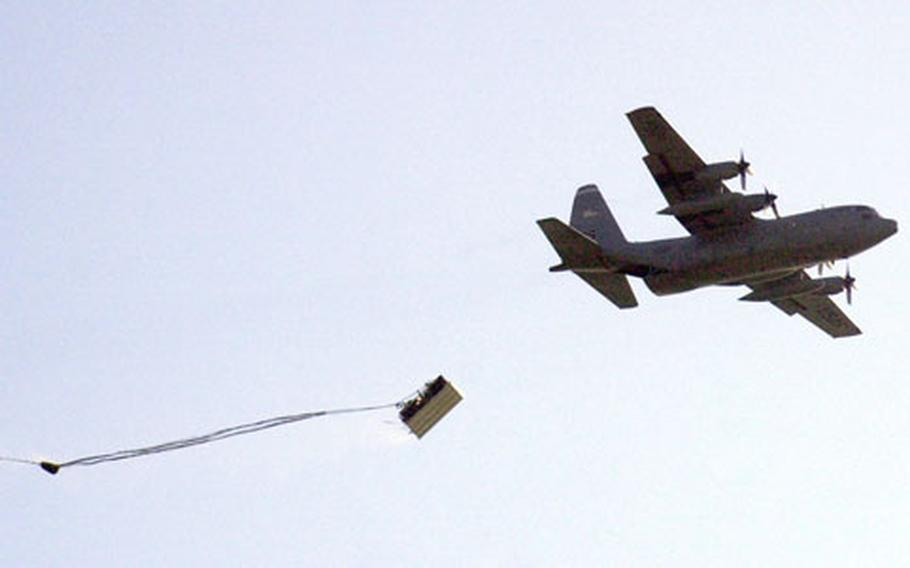 A Humvee falls from the back of a C-130 transport aircraft over Hohenfels, Germany, on Wednesday.
