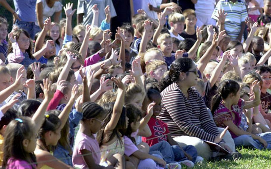 Many of the students at Bechtel Elementary School raised their hands when military-working-dog handlers asked if they had pets at home.