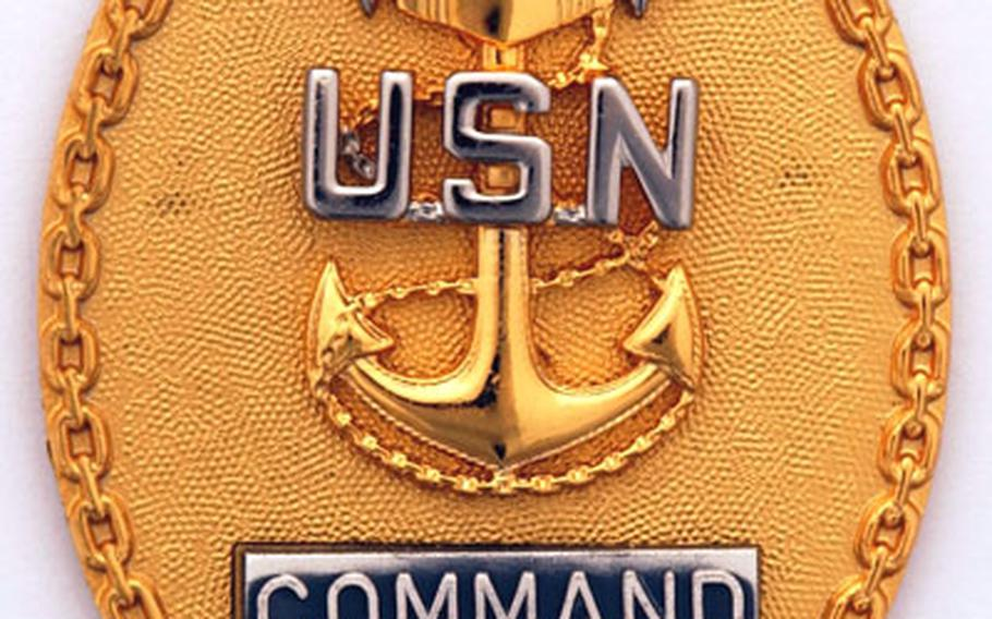 The command master chief (CMC) badge has been returned to its traditional location on the Navy uniform.