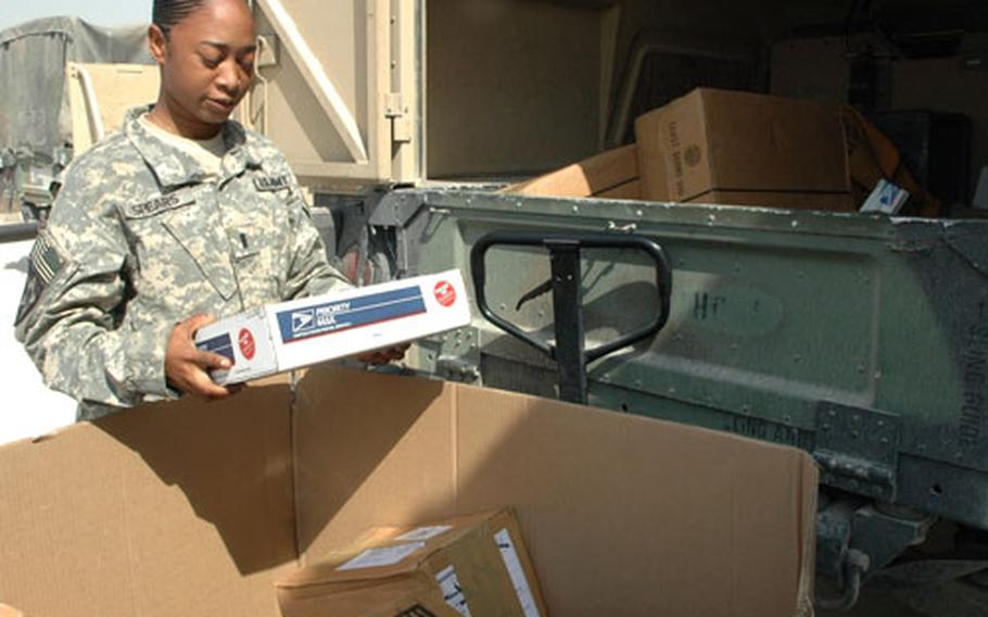 What's in the box? Most care packages contain snacks, candy and hygiene items. But occasionally, they carry stranger fare. First Lt. Nicole Spears, 26, of Shreveport, La., examines a box as she picks up mail for her unit Thursday at Camp Victory.