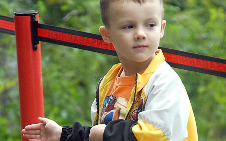 Valen Penn, 4, helps guide runners to the finish line at the 2006 Frankenstein Castle Run.