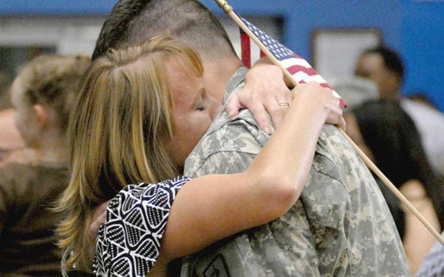 Capt. Christopher Gilbert and his wife, Katherine, share a moment after his return home Thursday from a one-year deployment to Balad Air Base, Iraq.