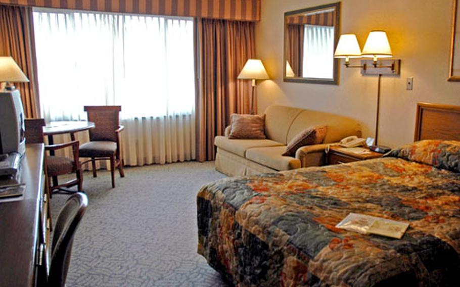 This standard room at the Dragon Hill Lodge ranges in price from $55 to $213 a night, depending on the customer's military rank and traveling status.