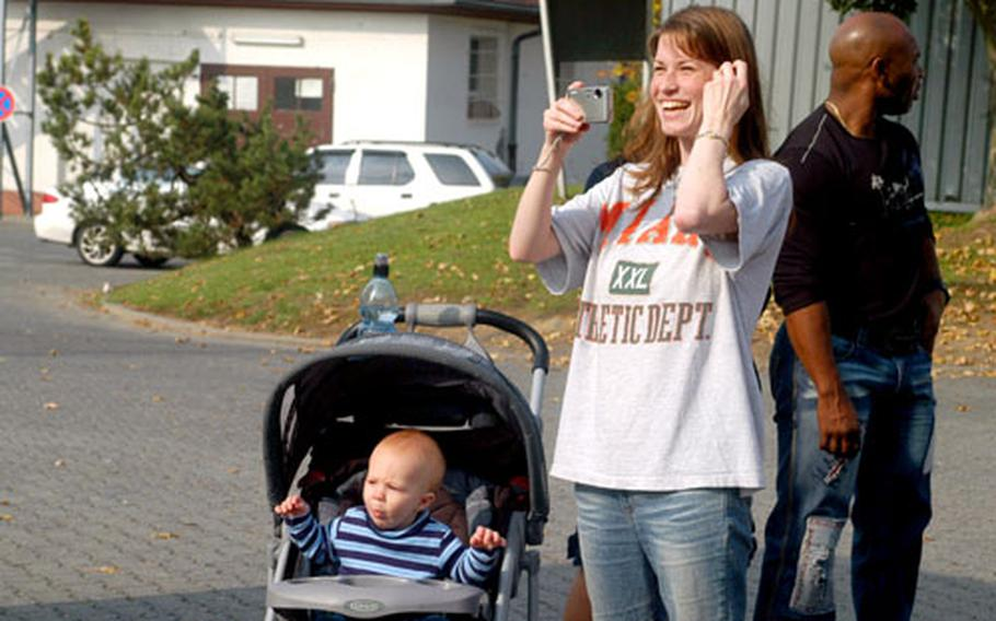 Christina Jacobson roots for her husband, Jake Jacobson, with an assist from James, 10 months.