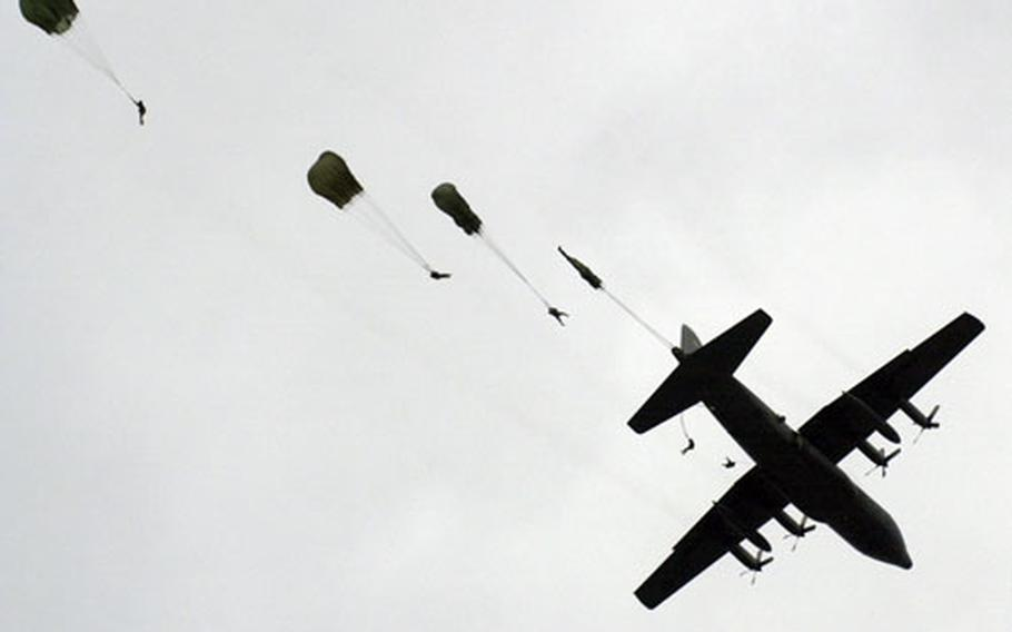 Soldiers from the 173rd Airborne Brigade parachute from a C-130 over Grafenwöhr Training Area in Germany on Monday.